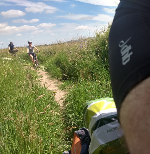 Wessex Ridgeway north of Devizes, 3 bikes riding a baked mud path