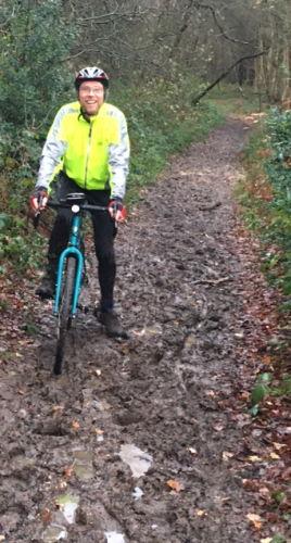 Muddy track, happy cyclist