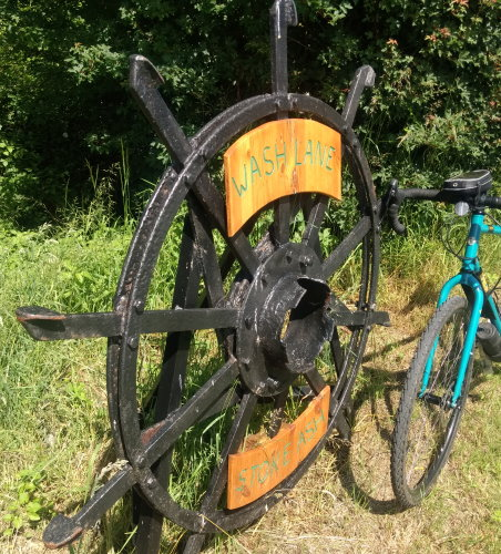 Old farm equipment as place sign